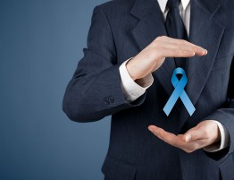 Prostate cancer awareness peace and genetic disorder awareness - man with protective and support gesture and blue ribbon.